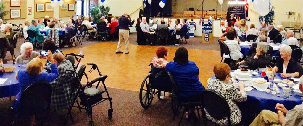 Seniors enjoy a Hanukkah holiday luncheon recently at Temple Beth-El in Ormond Beach.
