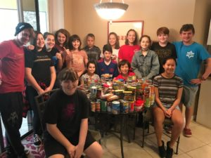 The Youth Groups from Temple Beth-El and Congregation B'nai Torah in Ormond Beach collected plenty of food, including, back row, left to right: Matthew Berman, Bailey Waigand, Hannah Blake, Alexa Wolfson, Libi Wolfson, Robby Tew, Hallie Silverstein, Grace Silverstein, Johanna Freeman, Jacob Friedman and Zach Berman. Front row, around the table, are: Ana Chuven, Sophia Morse, Bennett Morse, Brandon Liebman, and Sydney Nusbaum.