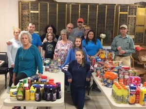 The Youth Group from Temple Beth Shalom in Palm Coast filled many tables with all the donations. Helping were: back row, left to right, Robyn Holbrook, Brandon Holbrook, Jessica Barron, Haydon Barron, Joel Friedman, Frieda Friedman, Tito Kraer, Kris Kraer, Fran Gartner and Jerry King, and front left, Jan Ryone, middle row, kneeling, Eliana Kraer, and behind her, Aliya Kraer.