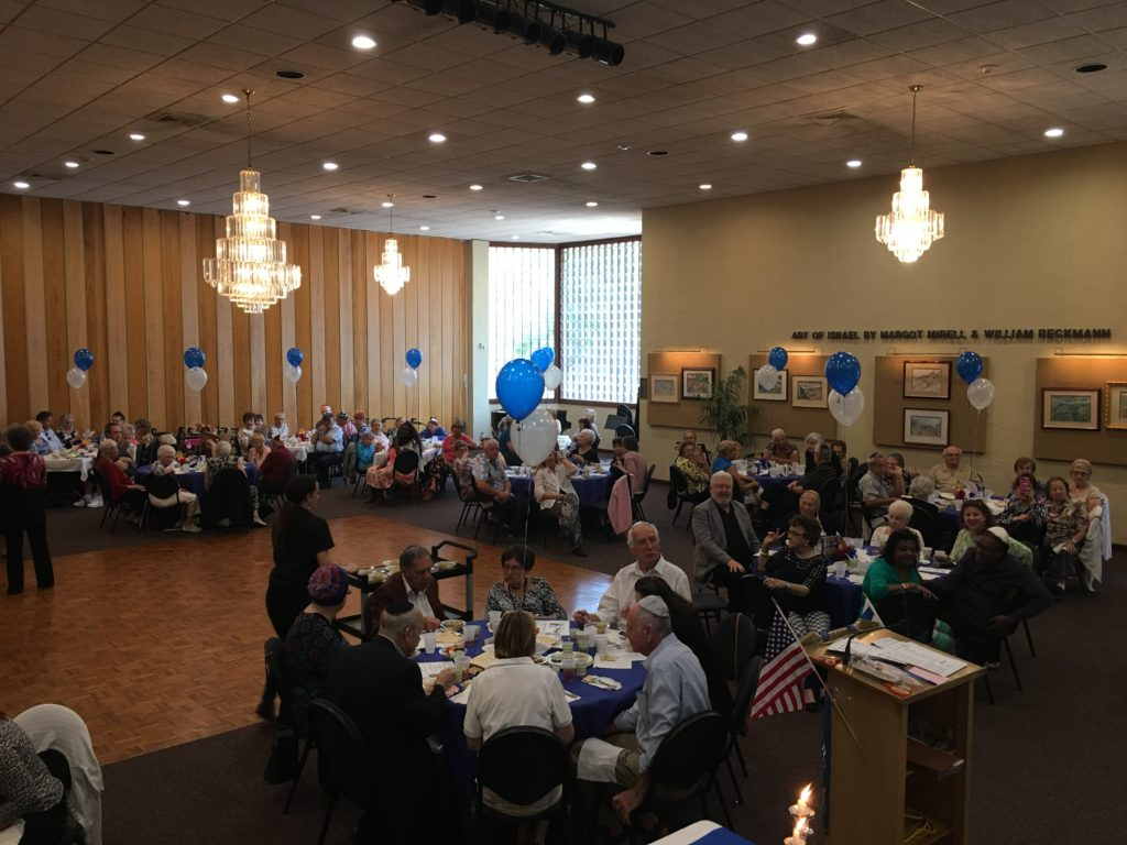 Seniors enjoy a Passover lunch at Temple Beth-El.